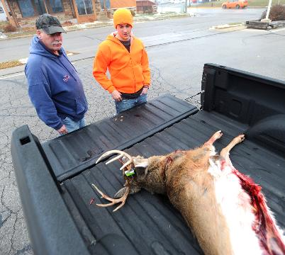 Deer hunters register deer on opening day of gun season at Holiday Food and Sports in Waupun.