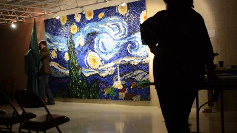 """Recycled plastic bottle caps were used to recreate the famous """"Starry Night"""" piece by Vincent Van Gogh in an almost three-year-long art project, unveiled on Saturday, Nov. 8, 2014 at the Rahr-West Art Museum in Manitowoc."""