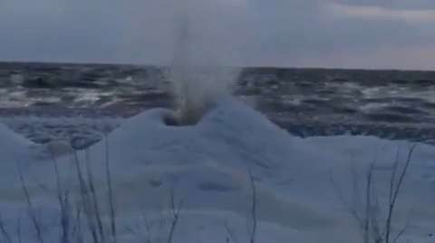 An winter ice phenonemon called an 'ice volcano' was discovered by Wisconsin Department of Natural Resources staff on the Bay of Green Bay, Dec. 2, 2014.