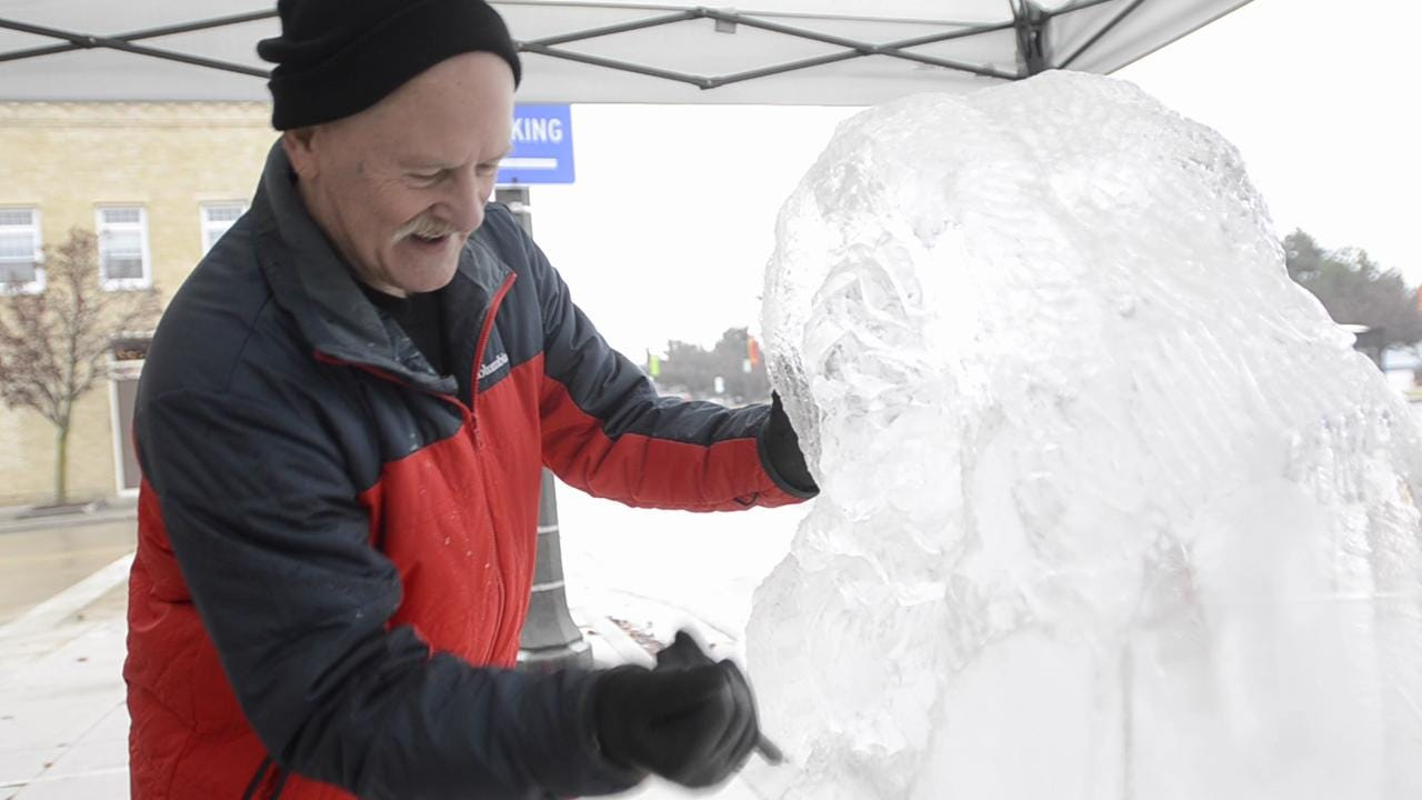 Ice on 8th sculpting event draws visitors to downtown Manitowoc for a unique and interesting visual experience on Saturday, December 27, 2014.