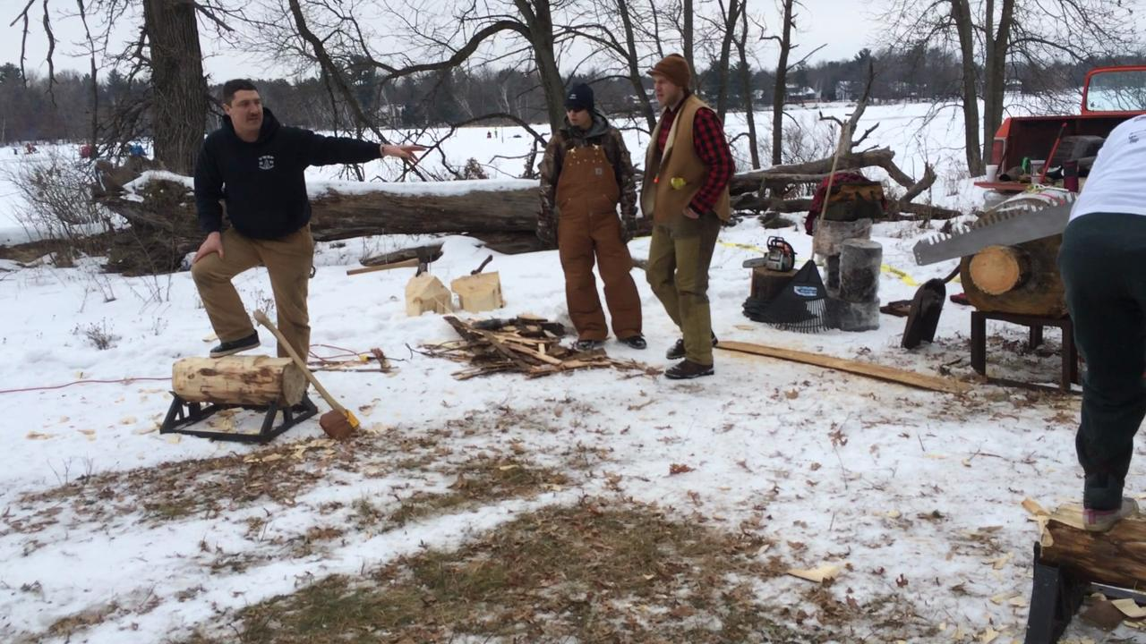 Members of the UWSP Woodland Sports team demonstrate the use of an ax at the 51st annual Izaak Walton Winter Jamboree.