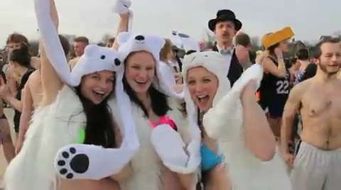 Sheboygan Polar Bears frolic in Lake Michigan for the 45th annual Polar Bear dip.