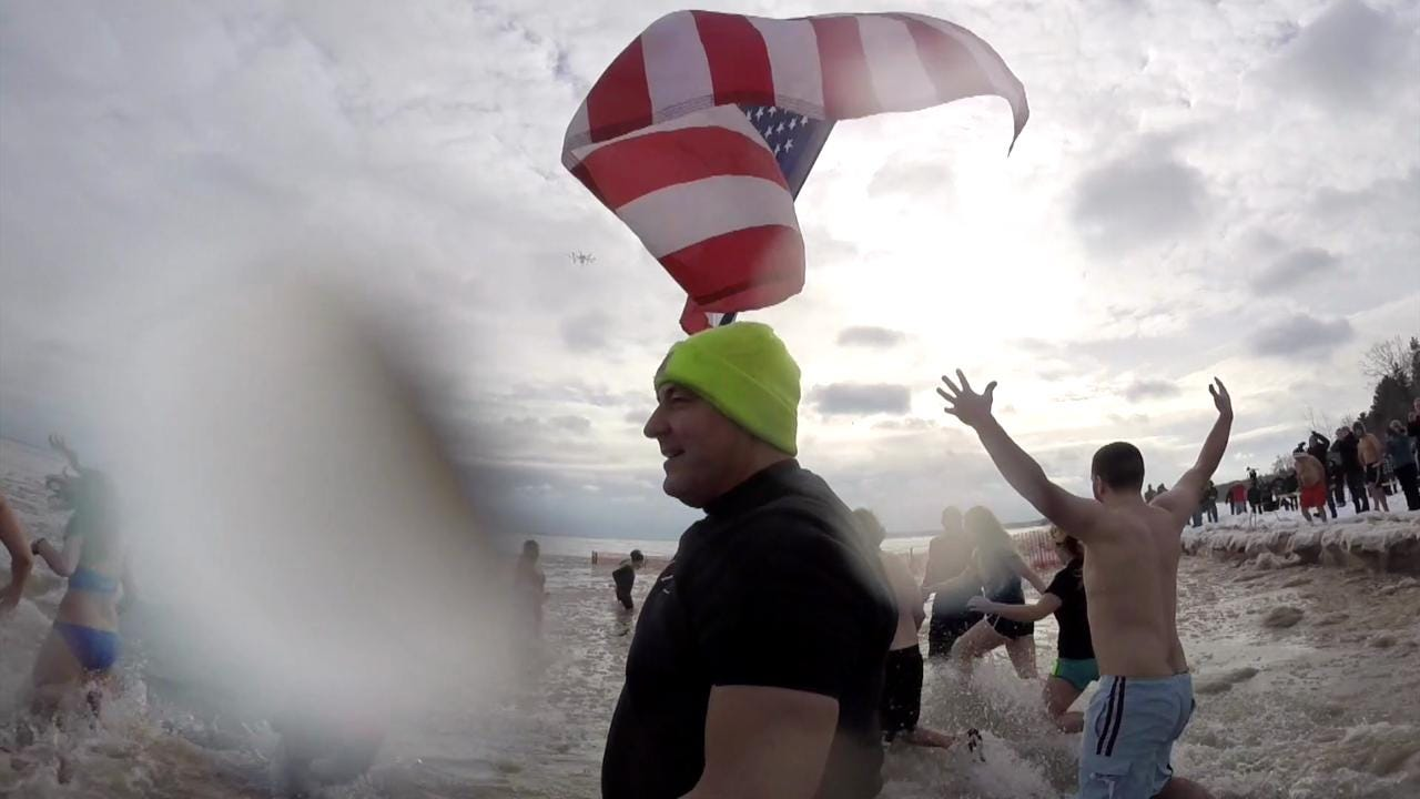 Hundreds braved the cold to romp around in a frigid Lake Michigan for the Jacksonport Polar Bear Club's annual swim on New Year's Day 2015. (Jan. 1, 2015)