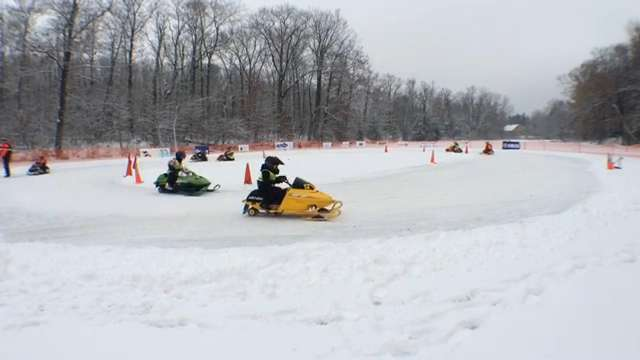 The Big Boy Kitty Kats began their racing season Saturday at Anchor Bay Bar and Grill in Biron. The children race small snowmobiles around an oval ice track. Karen Madden/Daily Tribune Media