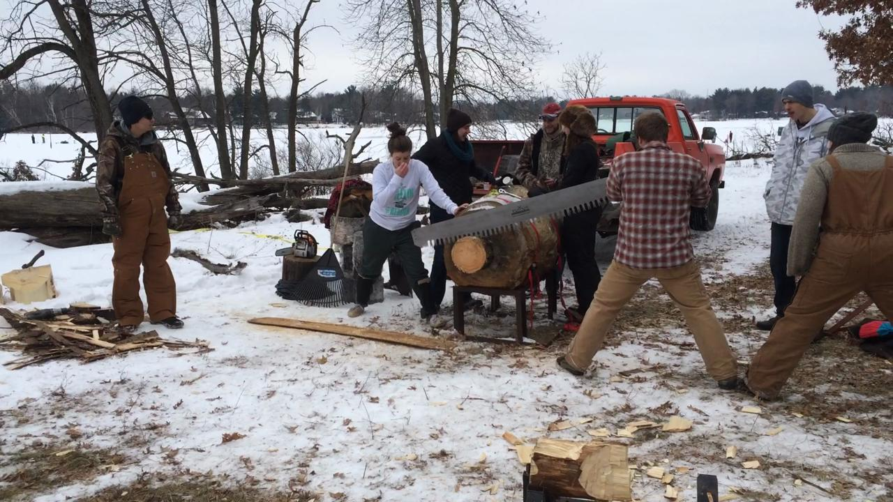 Members of the UWSP Woodland Sports team demonstrate the use of a saw at the 51st annual Izaak Walton Winter Jamboree.