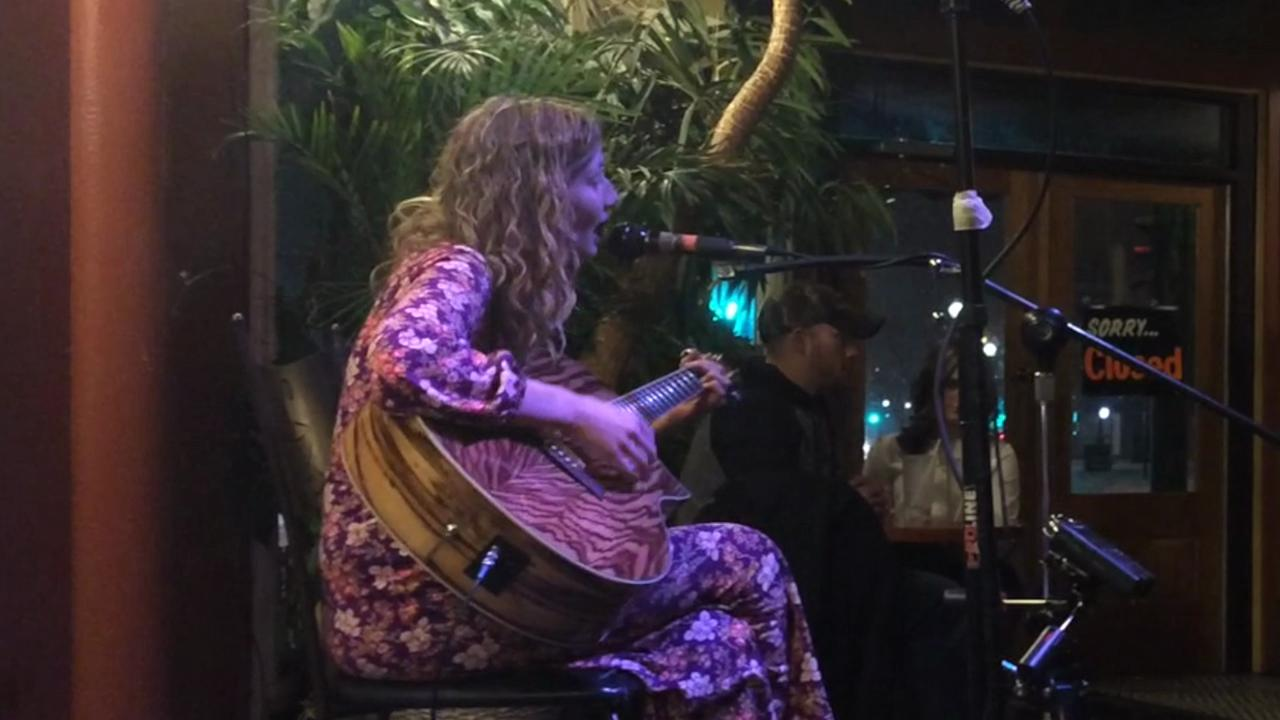 "Melody John performs ""Free bird"" during Open Mic Night at New Moon Cafe on Feb. 3. (Feb. 5, 2015)"