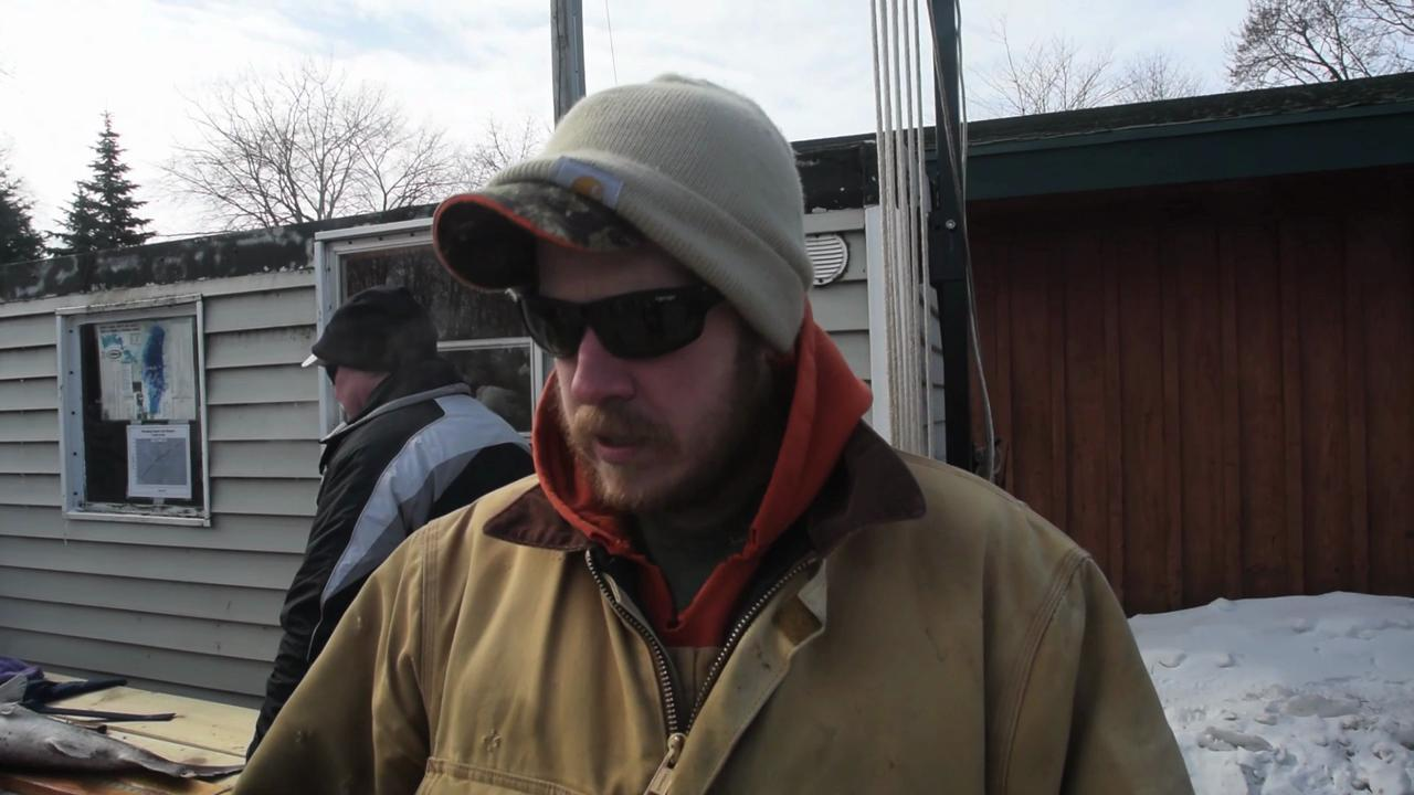 Mike Herrman, an owner of Eden's Meat Market, said his texting nearly caused him to miss his first sturgeon in 12 years of spearing Sunday, Feb. 15, 2015.