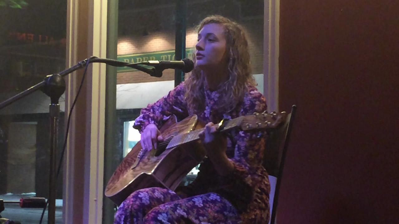 "Melody John performs ""Thanks for your concern"" during Open Mic Night at New Moon Cafe in Oshkosh on Feb. 3. (Feb. 5, 2015)"