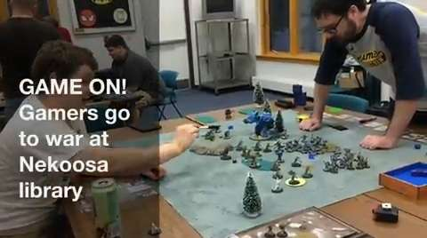 """Tuesday night is game night at the Charles and JoAnn Lester Library in Nekoosa, when gamers gather to play wargames. Using handpainted figurines, the games are strategic-driven. One gamer called it """"chess on steroids."""" (Deb Cleworth/Aug. 19, 2015)"""