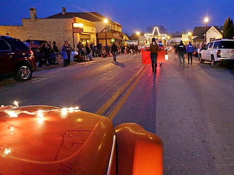 A view of the Sheboygan Falls Main Street Memories and Holiday Parade 2015 from an entrant in the parade, David Weinhold's 1957 Volkswagen Beetle.