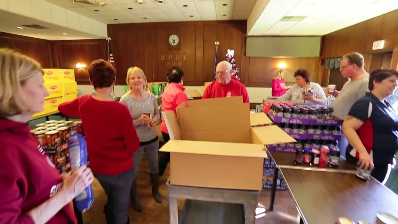 Sheboygan Elks Club 12 Weeks of Christmas programs will provide food and other staples to over 100 Sheboygan families who are less fortunate.  Elks volunteers gathered Saturday to assemble and distribute the kits.