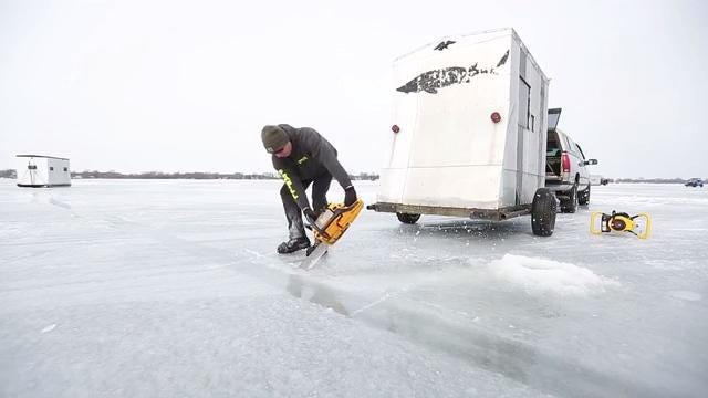 Follow along with sturgeon spearers as they cut holes and position shanties in advance of sturgeon spearing season