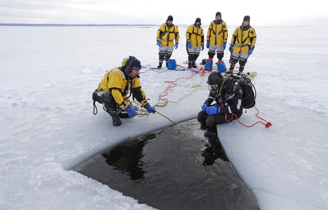 Neenah-Menasha Fire Rescue crews conduct dive rescue training on Lake Winnebago for the upcoming sturgeon fishing season