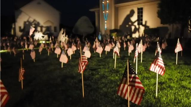 The house of Marty Ryan, at 10 Corvette Circle in Fond du Lac, will host hundreds of flags and two large silhouettes over Memorial Day weekend.  Taima Kern/USA TODAY NETWORK-Wisconsin